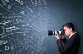 Photographer shooting images while energetic hand drawn lines an — Stock Photo