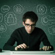 Young nerd hacker with virus and hacking thoughts — Stock Photo #32862237