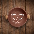 Happy smiley cartoon face on colorful dish plate — Стоковая фотография