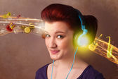 Young woman with headphones listening to music — Photo