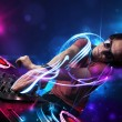 Disc jockey playing music with electro light effects and lights — 图库照片
