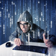 Stock Photo: Hacker decoding information from futuristic network technology