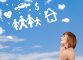 Młoda dziewczyna marzeń z rodziny i gospodarstwa domowego chmury — Zdjęcie stockowe
