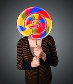 Young woman holding a lollipop — Stock Photo