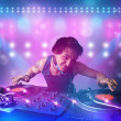 Disc jockey mixing music on turntables on stage with lights and — Stock Photo