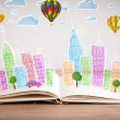 Cityscape drawing on open book — Stock Photo