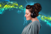 Young woman listening to music with headphones — Stock Photo