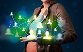 Young woman presenting modern technology social network map — Stock Photo