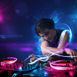 Stock Photo: Disc jockey playing music with electro light effects and lights