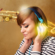 Young woman with headphones listening to music — Stock Photo