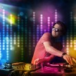 Stock Photo: Dj playing songs in disco with light show