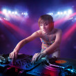 Teenager Dj mixing records in front of a crowd on stage — Foto Stock