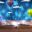Open book with glowing fantasy abstract clouds and balloons — Stock Photo