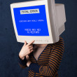 Stock Photo: Person with monitor head and fatal error blue screen on di