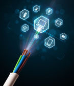 Electric cable with multimedia icons — Stock Photo