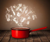 Cooking icons coming out from cooking pot — Stock Photo