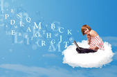 Young woman sitting in cloud with laptop — Stock fotografie