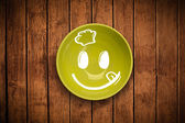 Visage cartoon smiley heureux sur plaque plat coloré — Photo