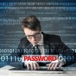 Young geek hacker stealing password — ストック写真