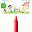 Crayon close-up with a drawing of a family — Stock Photo