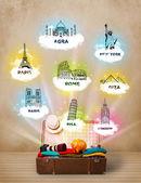 Valigia turistico con monumenti famosi nel mondo — Foto Stock