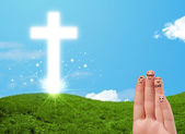 Happy finger smileys with christian religion cross — Stockfoto