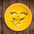 Happy smiley cartoon face on colorful dish plate — Stockfoto