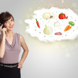 Pretty woman presenting a cloud of healthy nutritional vegetable — Stock Photo