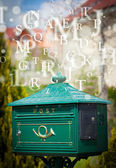 Mail box with letters comming out — Stock Photo