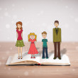 Drawing of a happy family on opened book — Stock Photo