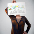 Woman holding a paper with charts and cityscape in front of her — Stockfoto
