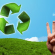 Happy smiley fingers looking at green leaf recycle sign — Foto de Stock