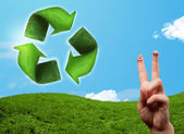 Happy smiley fingers looking at green leaf recycle sign — Foto Stock