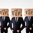 Men gesturing with exclamation marks on box on their head — Stockfoto