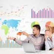 Business man and woman with colorful charts — Stock Photo