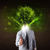 Man with green tree head concept — Stockfoto