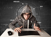 Young hacker in futuristic enviroment hacking personal informati — Stock Photo