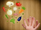Happy smiley face fingers looking at illustration of colorful he — Stockfoto