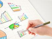 Persona de negocios coloridos gráficos e iconos de dibujo sobre papel — Foto de Stock