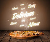 Pizza with delicious and tasty glowing writings — Stock Photo