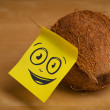 Post-it note with smiley face sticked on coconut — Stock Photo