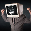 Stock Photo: Happy businessman with a PC monitor head and a smiley face