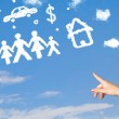 Hand pointing at family and household clouds — Stock Photo #37478809