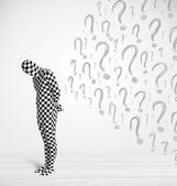 3d human character is body suit looking at hand drawn question m — Stock Photo