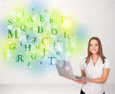 Business women with glowing letter concept — Stock Photo