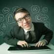 Stock Photo: Young nerd hacker with virus and hacking thoughts