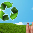Stock Photo: Happy smiley fingers looking at green leaf recycle sign