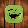Stock Photo: Happy smiley cartoon face on colorful dish plate