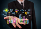 Young businessman presenting colorful hand drawn metropolitan ci — Stock Photo
