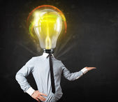 Business man with light bulb head concept — Stock Photo